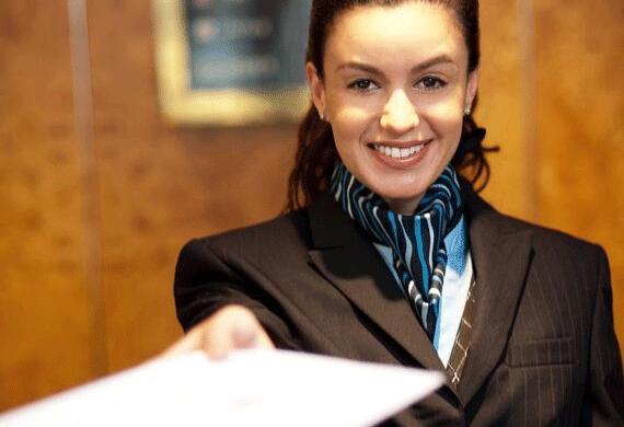A smiling concierge staff